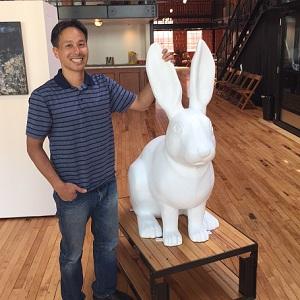 Lee Sie picking up his rabbit