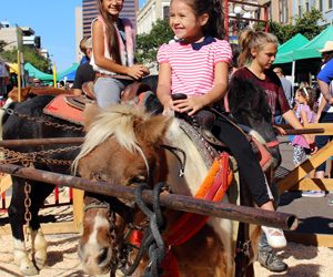 Fall Back in Time this Sunday with a Free Children's Historical Street Fair!
